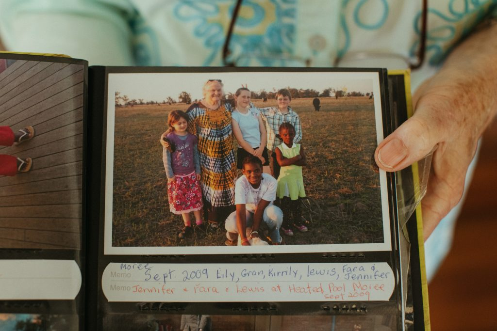 A close up of a photo of children in a photo album.