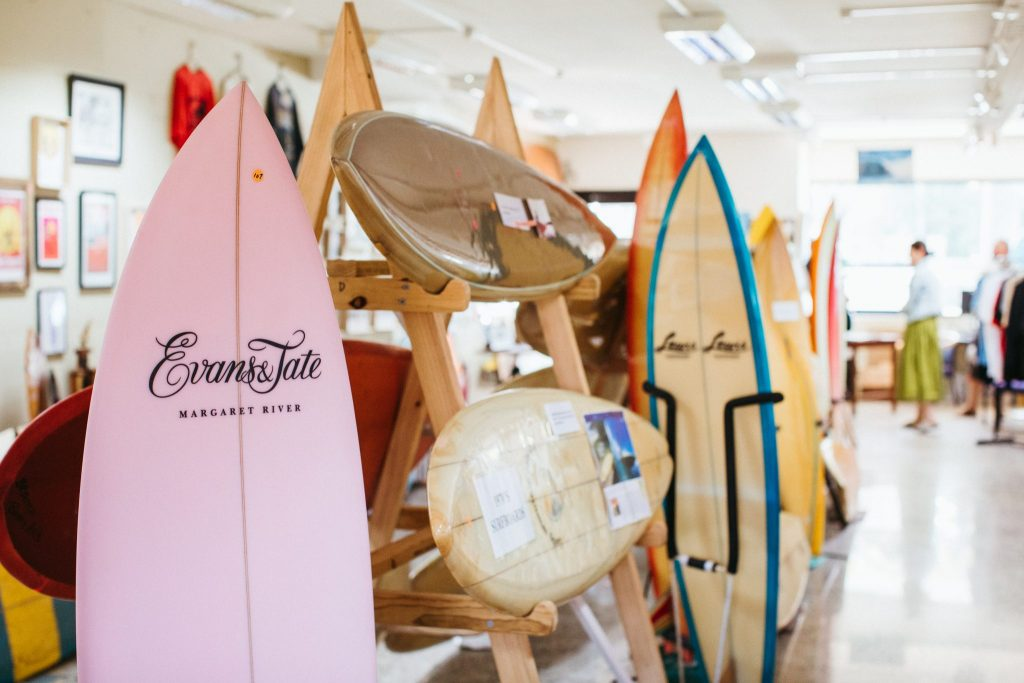 A collection or old and new surfboards